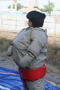 photo of man wearing sumo suit